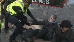 RCMP arrest 3 protesters who zap-strapped themselves to Kinder Morgan gate