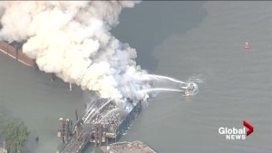 Vancouver fireboat battles large barge fire on Fraser River