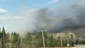 Submitted video shows black smoke rising over Caddy Lake
