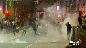 Riot police fire tear gas at demonstrators in Sham Shui Po