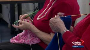 Airdrie seniors bring winter warmth to Calgary homeless shelter