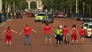 Protesters block Boris Johnson's motorcade en route to meeting with the Queen