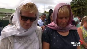 New Zealand shooting: Women of all faiths don headscarves to support Muslim community