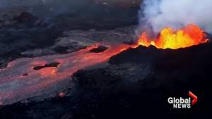 Dramatic aerials trace Kilauea's lava flow as it cuts across Hawaii into the ocean