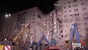 Rescue and recovery teams pour over site of building collapse in Russia