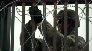 U.S. military lays barbed wire at Texas border with Mexico as migrant caravan nears