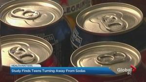 High school students avoiding soda drinks