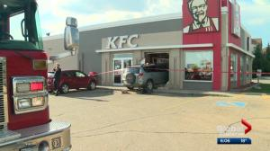 Attempted murder charge laid against woman after SUV crashes into Edmonton KFC