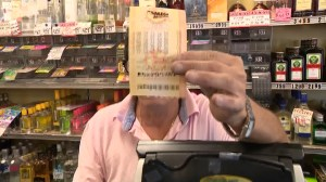 With Mega Millions and Powerball totaling more than $2B, lottery fever spikes in U.S.
