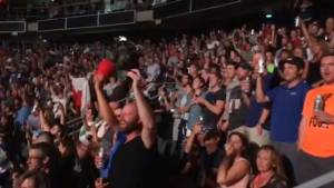 The Tragically Hip's fans sing 'O Canada' before historic concert