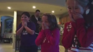 Parents surprise daughters with new adopted baby under Christmas tree