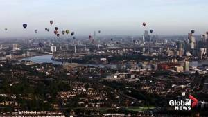 Hot air balloons fill the skies over London