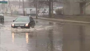 Flooding continues in Fredericton as rain falls on Saturday