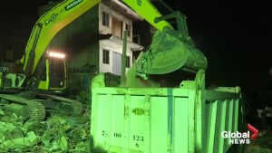 Emergency crews continue search of school collapse as night falls