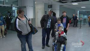 Families fleeing Fort McMurray wildfire arrive at Toronto Pearson Airport