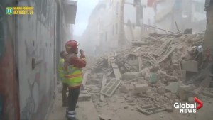 Rescue workers comb through wreckage of building collapse in Marseilles, France