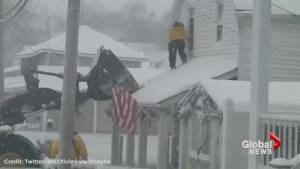 Loader rescues people trapped by frozen floodwaters in Massachusetts