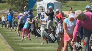 Masters champion Larry Mize shows juniors how to improve their golf game