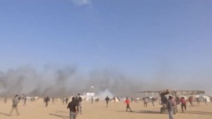 Drone seen dropping tear gas on protesters in Gaza