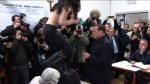Topless FEMEN protester disrupts Berlusconi at Italian polling station