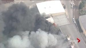 Stubborn warehouse fire continues to burn on Annacis Island