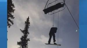 Footage shows skier forced to rappel down from Banff ski lift