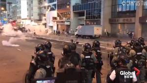 Dramatic footage shows police in Hong Kong deploying tear gas against protesters