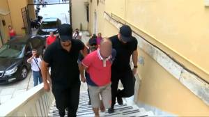 Man taken into custody in relation to murder of U.S. scientist in Greece