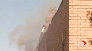 Toronto firefighter in hospital after being pulled from burning building (02:06)