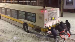 When Boston transit bus gets stuck in the snow, passengers get out to help push