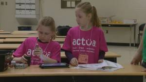 Earning badges through robotics, Girl Guides learning about careers in STEM