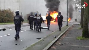 Students clash with police, burn car in Nantes