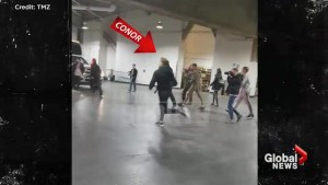 Cellphone footage shows MMA star Conor McGregor smashing through bus window at UFC event