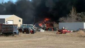 Grass fire destroys buildings and vehicles