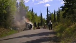 Dramatic video shows Alaska police, drivers rescue man from burning vehicle