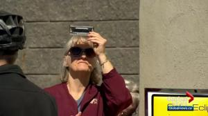 Saskatoon solar eclipse watchers: 'a miracle of nature unfolding in front of our eyes'