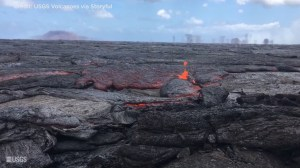 Shifting crust pops open to belch lava at Hawaii's Kilauea volcano