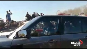 Iraqi provincial governor drives car through crowd furious about deadly ferry accident