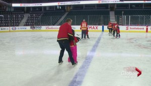Calgary Flames players and alumni share Saddledome ice with visually impaired