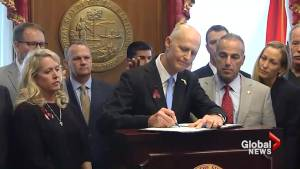 Florida Gov. Rick Scott signs gun bill after Parkland shooting