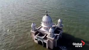 Indonesia's popular 'floating mosque' now sinking following earthquake