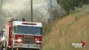 Crews work to contain wildfire near Merritt