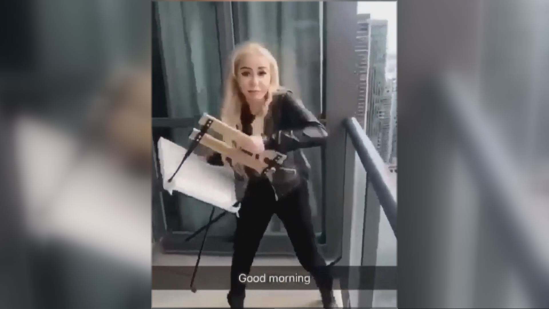 Police investigating video of woman throwing chair off condo balcony