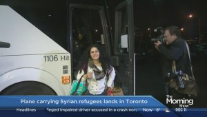 1st planeload of Syrian refugees land on Canadian soil