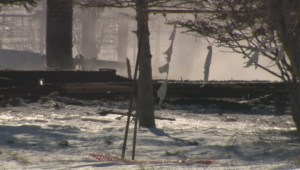 Smoke still rises from ruin of building where fatal fire claimed lives of 4 boys