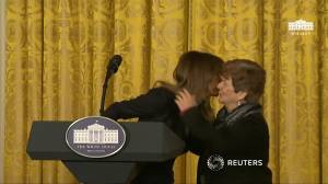 Melania Trump embraces mother who lost son to opioid overdose