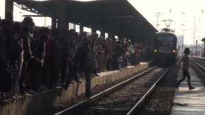 Hundreds of refugees pour onto trains in Budapest even as rail service suspended
