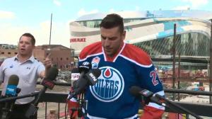 Milan Lucic puts on Edmonton Oilers jersey after signing 7-year, US$42M deal