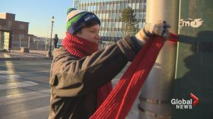 Moncton residents mark World Aids Day by hanging red scarves