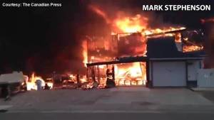 Fort McMurray firefighter forced to watch as fire consumes his own home